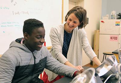 NYA science teacher with student 19 - credit Brian Beard - CIP