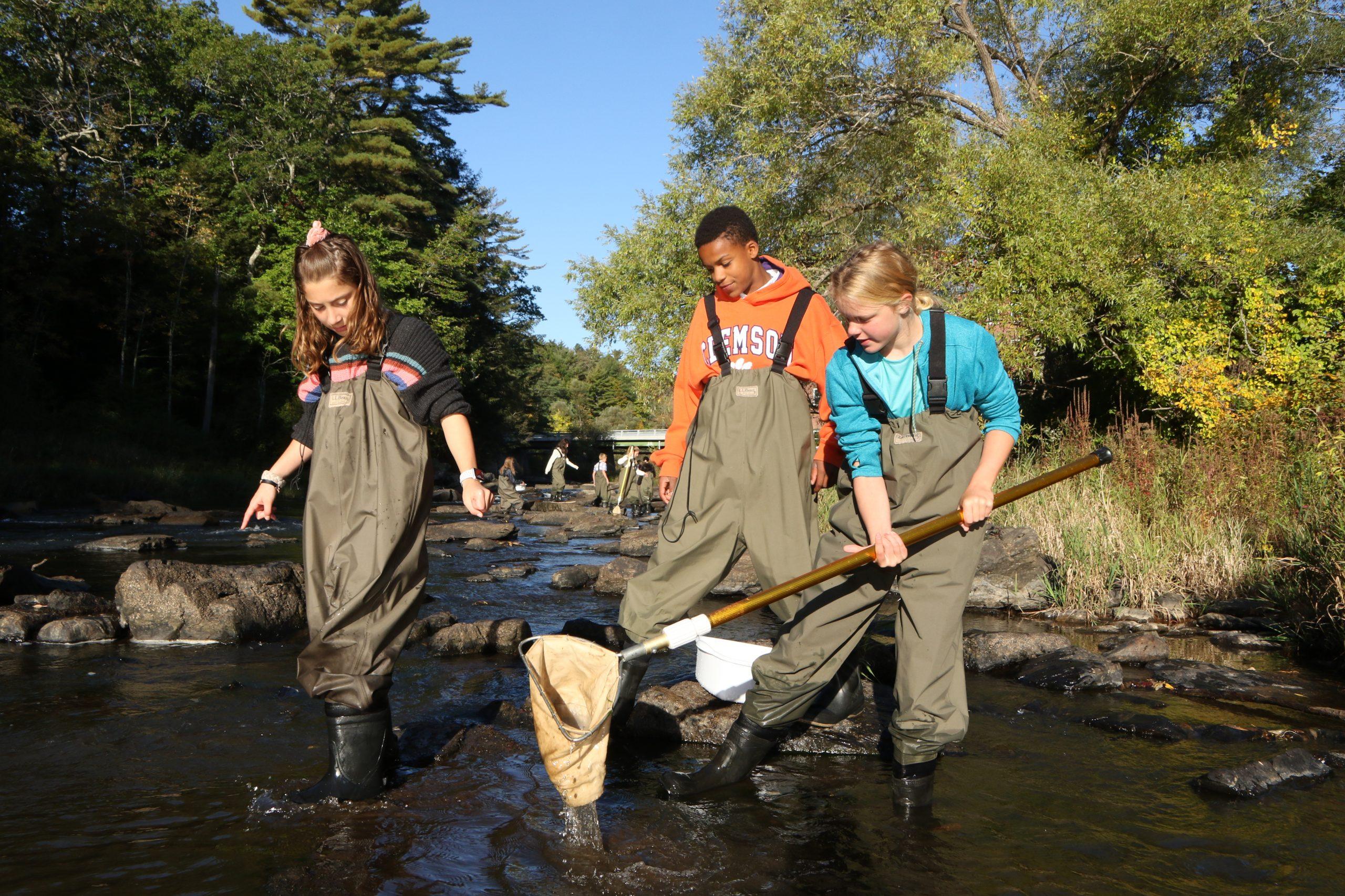 NYA studets fishing in the Royal River